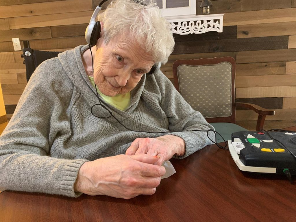 Jo reading at any age with an audio book player